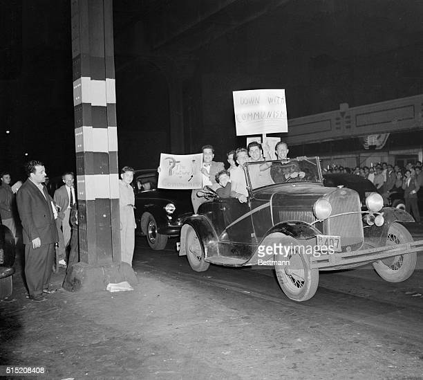 These jalopyriding motorists after they had seen pickets condemning the antiCommunist movie The Iron Curtain returned with placards supporting the...