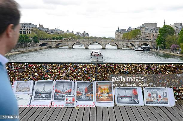 These love locks padlocks fastened to a bridge symbolizing lasting love some call a fungus which stains the City of Light Lovelorn couples buy a...