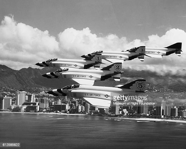 These McDonnell F4E Phantom II aircraft are part of the US Air Force's 'Thunderbirds' aerobatic team This veeformation is being demonstrated over...