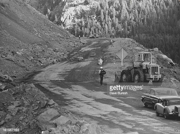 DEC 3 1966 DEC 18 1966 These Motorists must wait until Bulldozer clears boulders from middle of Highway near Silver Plume Colo They were among...