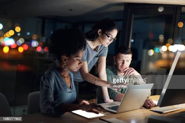 these night owls always work with dedication - cooperation stock pictures, royalty-free photos & images