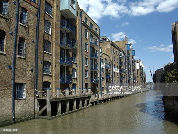 These old wharf buildings are beside a creek in Bermondsey, South London leading up to the Thames. They are now converted into apartments.