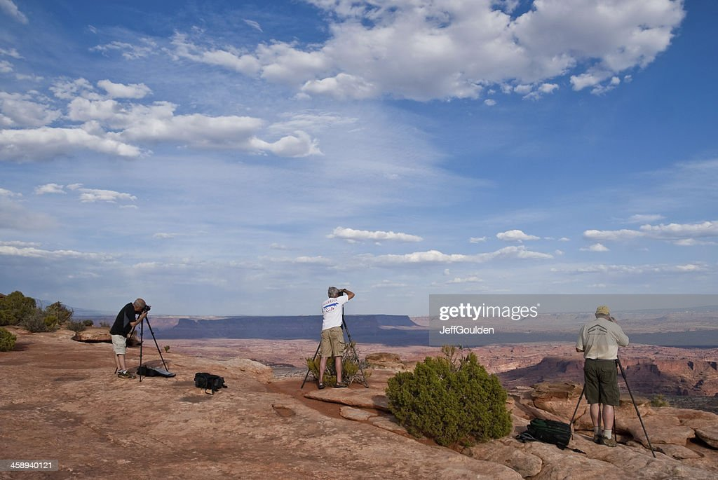 Three Photographers Lined Up on the Canyon Rim : Stock Photo