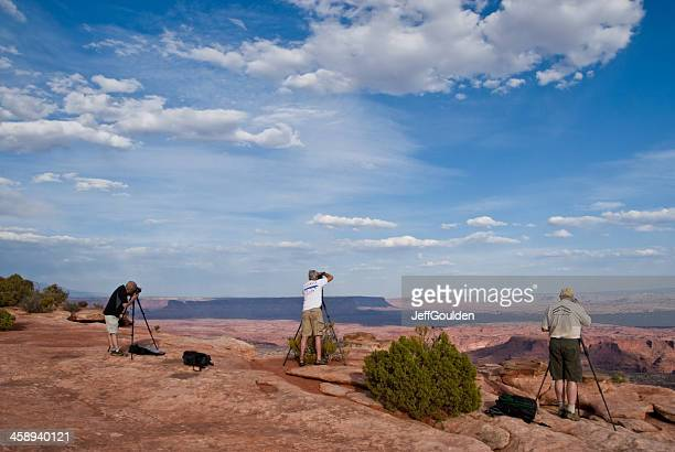 Three Photographers Lined Up on the Canyon Rim