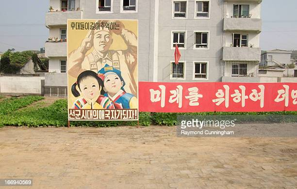 CONTENT] These propaganda posters are in every village and town in North Korea in some form