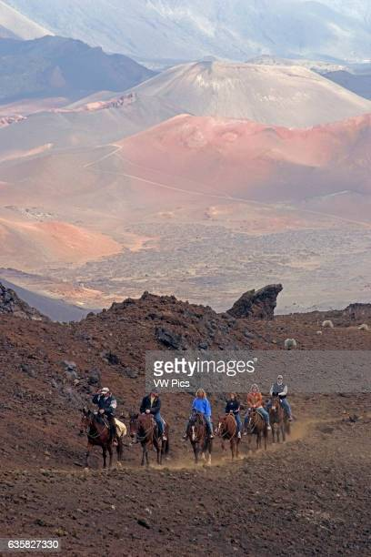 These riders are working their way up sliding sands trail out of Haleakala Crater Maui's dormant volcano Hawaii