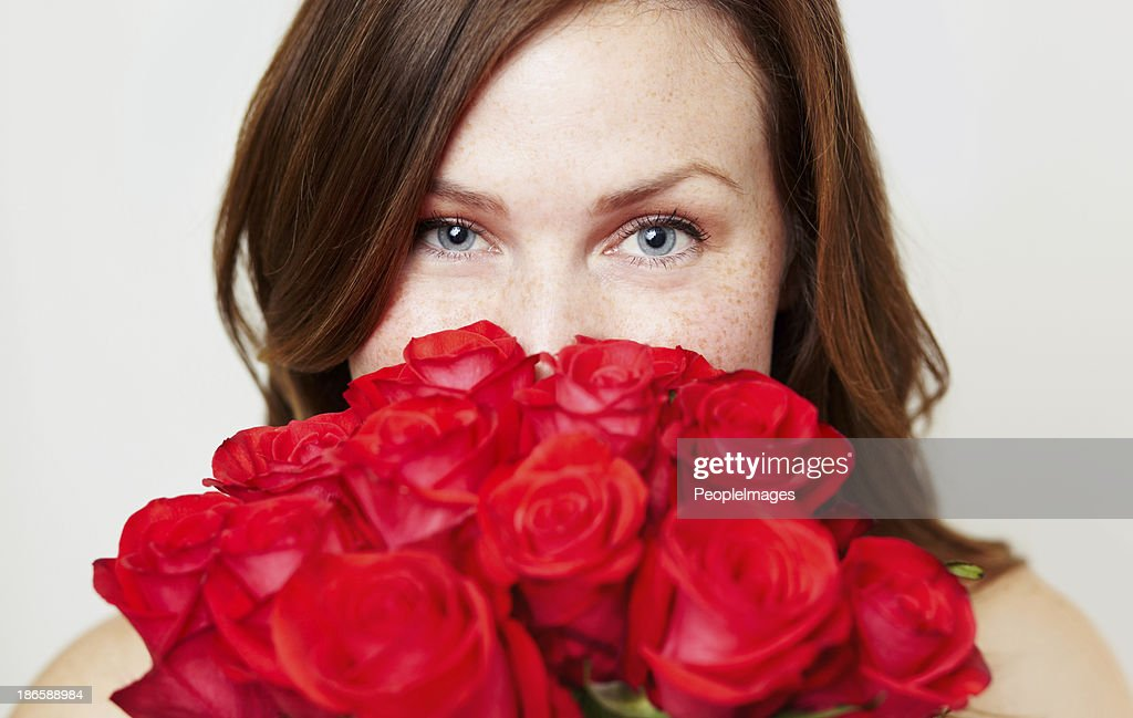 These roses smell good : Stock Photo