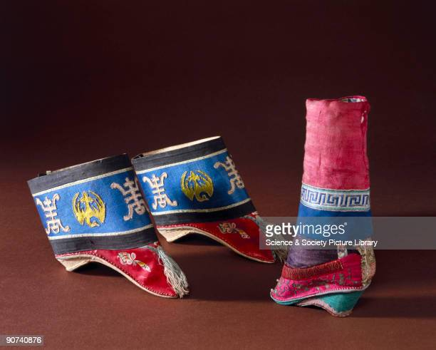 These shoes have a wooden sole with silk brocade uppers decorated with applique and embroidery Binding women's feet was a painful and crippling...
