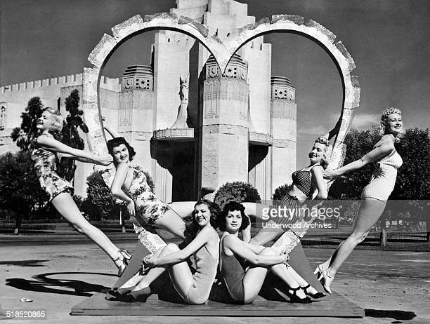 These six young women are ready for St Valentine's Day as they surround a heart at the South Tower of the Golden Gate International Exposition on...