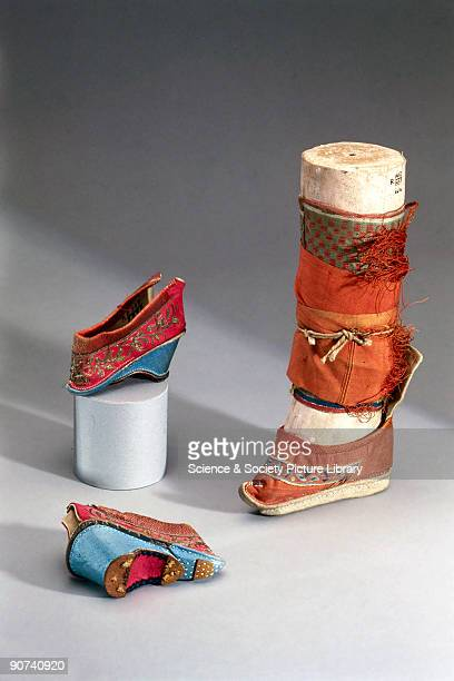These slippers have a wooden sole with silk brocade uppers decorated with applique and embroidery Binding women's feet was a painful and crippling...