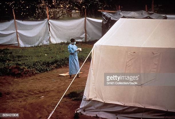 These temporary screens and tents were erected on the grounds of the Kikwit General Hospital located in Kikwit Zaire 1995 The screens in the...
