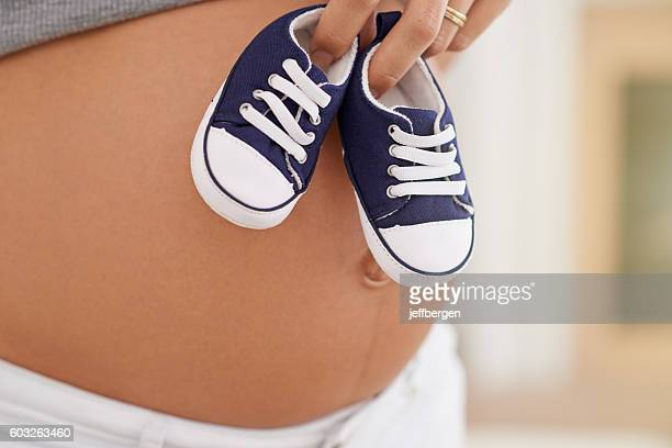 these tiny shoes are ready to be born - one young woman only stock pictures, royalty-free photos & images