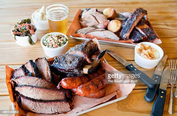 These two platters hold enough meat to serve a crowd Texas short ribs shiner bock brats and beef brisket pork spare ribs buttermilksoaked turkey...