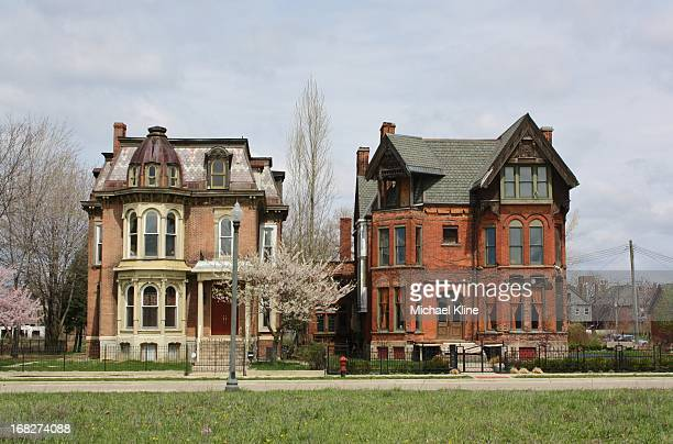 These two Victorian beauties have been saved from destruction in the old Brush Park neighborhood in Detroit. The house on the left looks to be...
