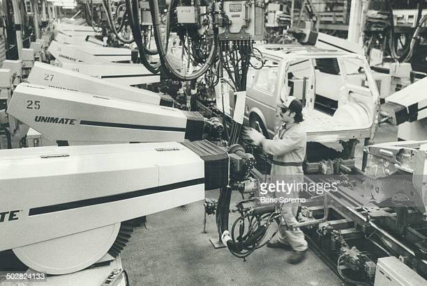 These workers won't strikes The 128 robots working the assembly line at Chrysler's minivan plant in Windsor don't mind the dull dirty and dangerous...