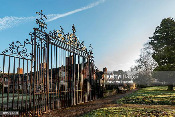 These wrought-iron gates by Robert Bakewell , hang outside the Sir John Port Almshouses and were restored in the 1980s. Martin