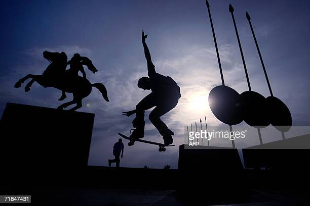 A skater is silhouetted in front of the statue of Alexander the Great in the northern Greek port city of Thessaloniki 11 September 2006 AFP PHOTO /...