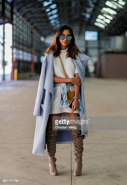 Thessy Kouzoukas wearing blue wool coat a creme dress and beige overknee shoes and a Mini Chloe bag outside Misha Collection at MercedesBenz Fashion...