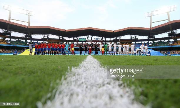 Theteams line up for national anthems during the FIFA U17 World Cup India 2017 Quarter Final match between Spain and Iran at Jawaharlal Nehru...