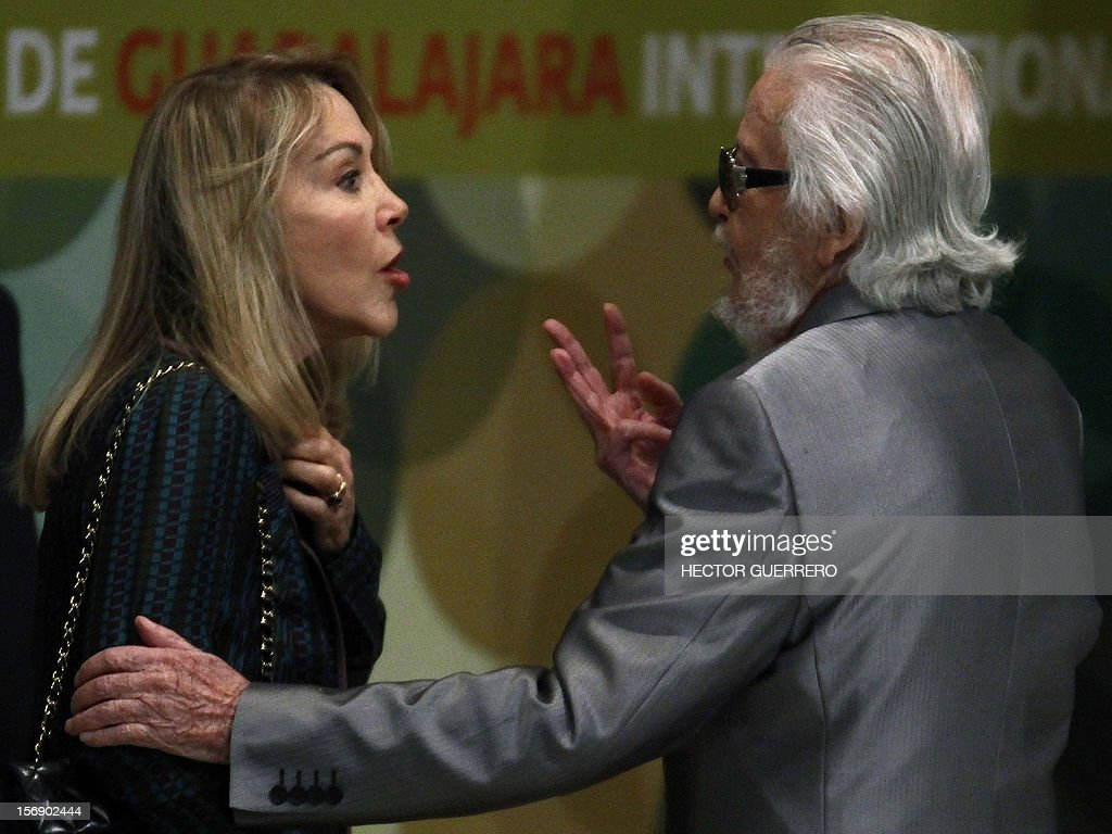 Thewidow of Mexican writer Carlos Fuentes, Silvia Lemus, (L) speaks with Mexican writer Fernando del Paso during the opening ceremony of the International Book Fair of Guadalajara, on November 24, 2012. AFP PHOTO/Hector Guerrero