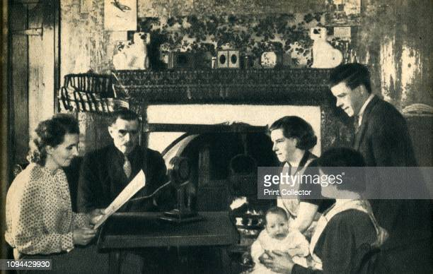 They also spoke and the Empire heard them A Scottish family taking part at home in the Christmas broadcast' 1942 From 'Calling All Nations' by T O...