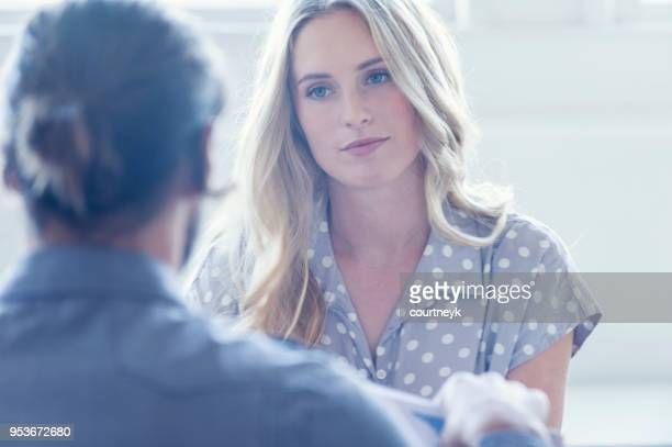 they are both young business people casually dressed in a bright office. - discussion stock photos and pictures