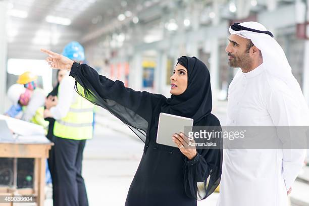 they are finishing up there! - united arab emirates stock pictures, royalty-free photos & images