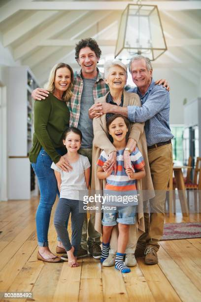 they are one close family - multigenerational family stock photos and pictures