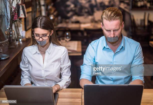 they are stuck in all the work waiting to be done. - modern slavery stock photos and pictures