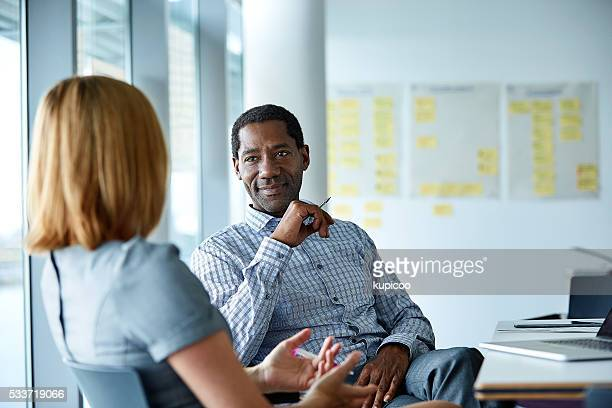 they enjoy a great working relationship - luisteren stockfoto's en -beelden