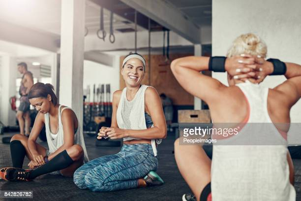 they enjoy hanging out as much as working out too - center athlete stock pictures, royalty-free photos & images