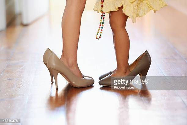 they have a lot of growing to do! - little girl in high heels stock photos and pictures