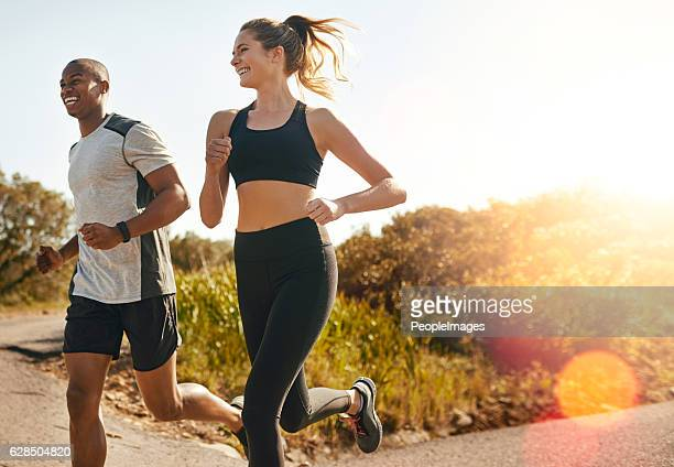 they keep each other going - jogging stock pictures, royalty-free photos & images