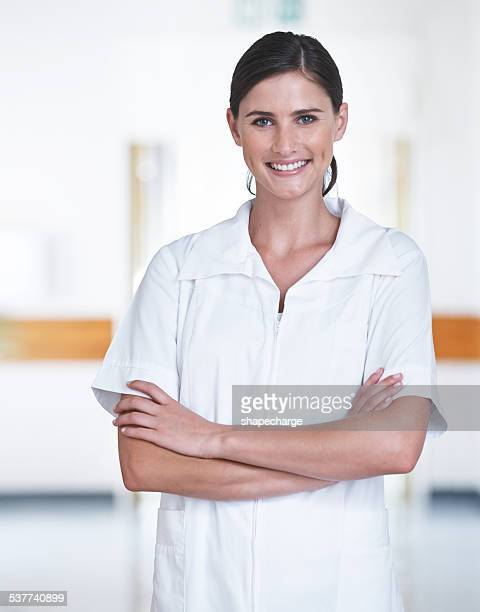 they know her as the friendly nurse - female nurse stock pictures, royalty-free photos & images