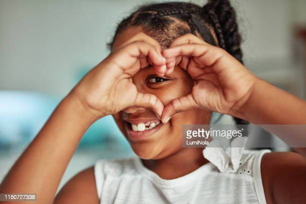 they learn to love through you - heart shape stock pictures, royalty-free photos & images