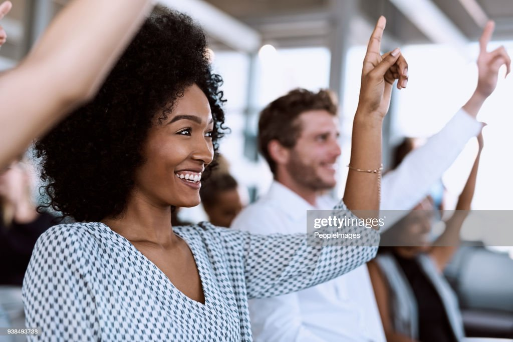 They like what they hear and want to know more : Stock Photo