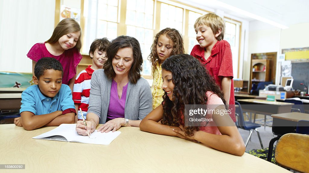 They love listening to their teacher's advice! : Stock Photo