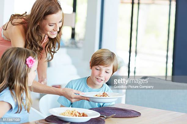 they love pasta dishes - mid adult women stock pictures, royalty-free photos & images