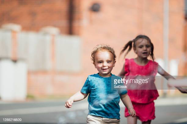 they love playing together - sibling stock pictures, royalty-free photos & images
