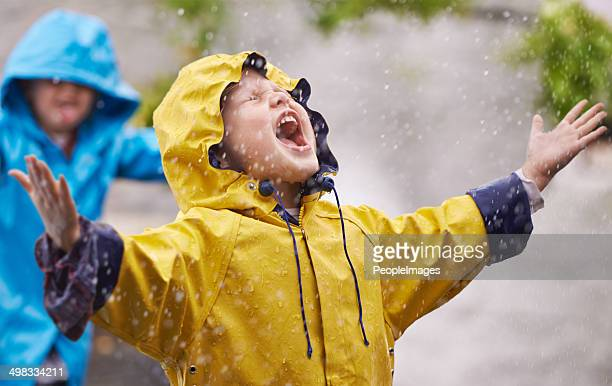 they love the rain - parka coat stock photos and pictures