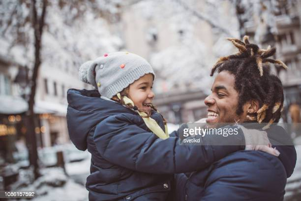 they love winter and snow - winter family stock photos and pictures