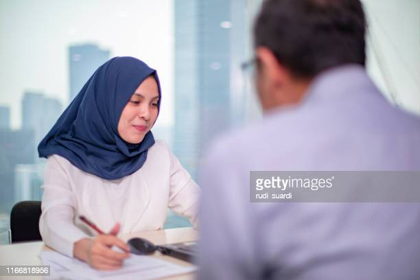 they share a great working relationship - religious veil stock pictures, royalty-free photos & images