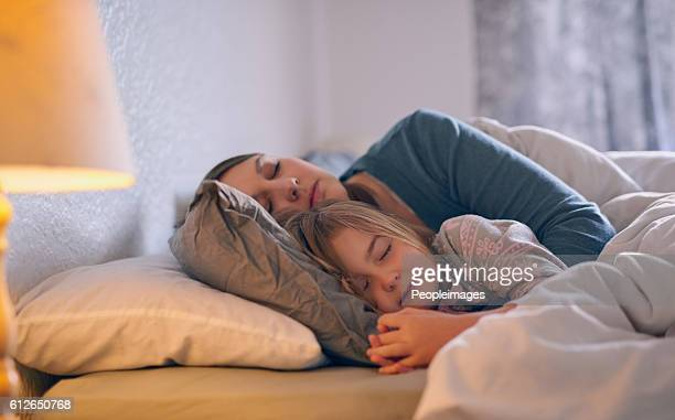 they spend every possible moment together - child in bed clothed stock pictures, royalty-free photos & images