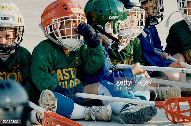 They start 'em young in lacrosse The boys and girls pictured on this page are in the junior peanut division of the Beaches League only 3 and 4 years...