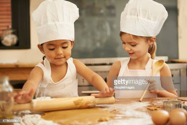 they'll make great bakers one day - chef's hat stock pictures, royalty-free photos & images