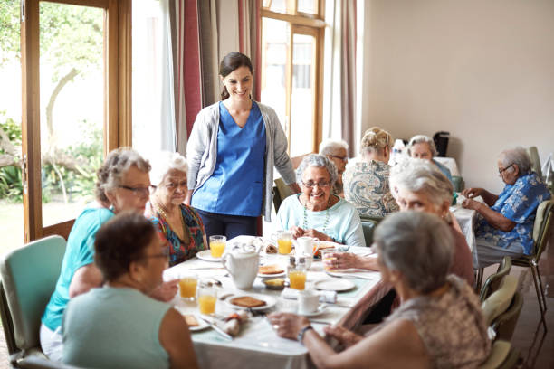 they're a cheerful bunch of seniors - eating in care home stock pictures, royalty-free photos & images