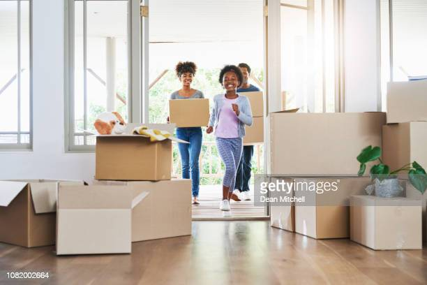they're all excited about the big move - unpacking stock pictures, royalty-free photos & images