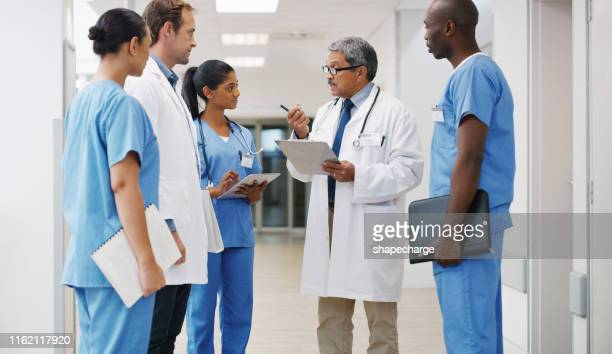 they're all trained and experienced to handle any medical matter - group of doctors stock pictures, royalty-free photos & images