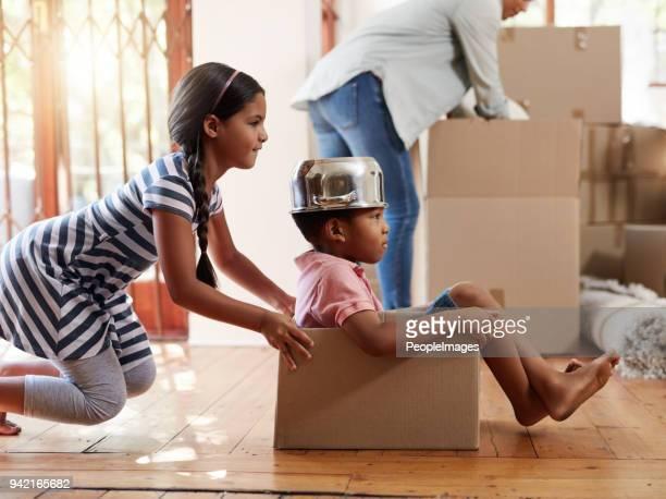 they're already filling their new home with tons of fun - empurrar atividade física imagens e fotografias de stock