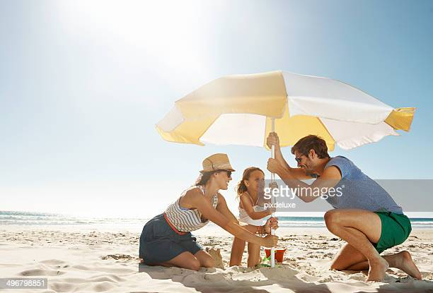 they're in it together - umbrella stock pictures, royalty-free photos & images